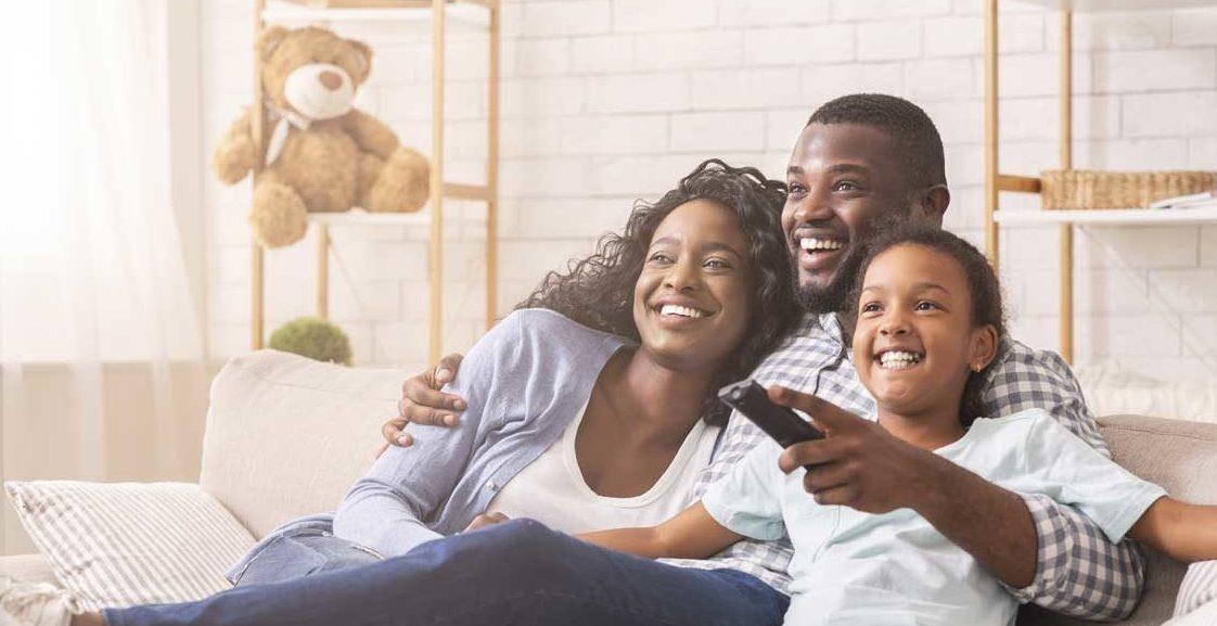 A family enjoying watching TV